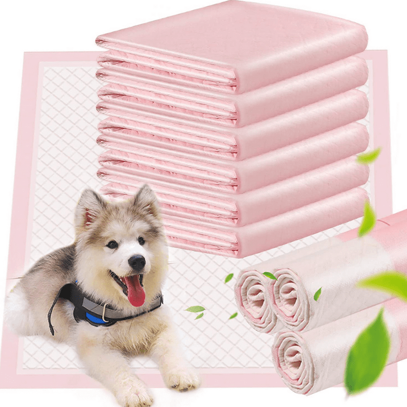 A pile of puppy pads and a dog laying down next to them