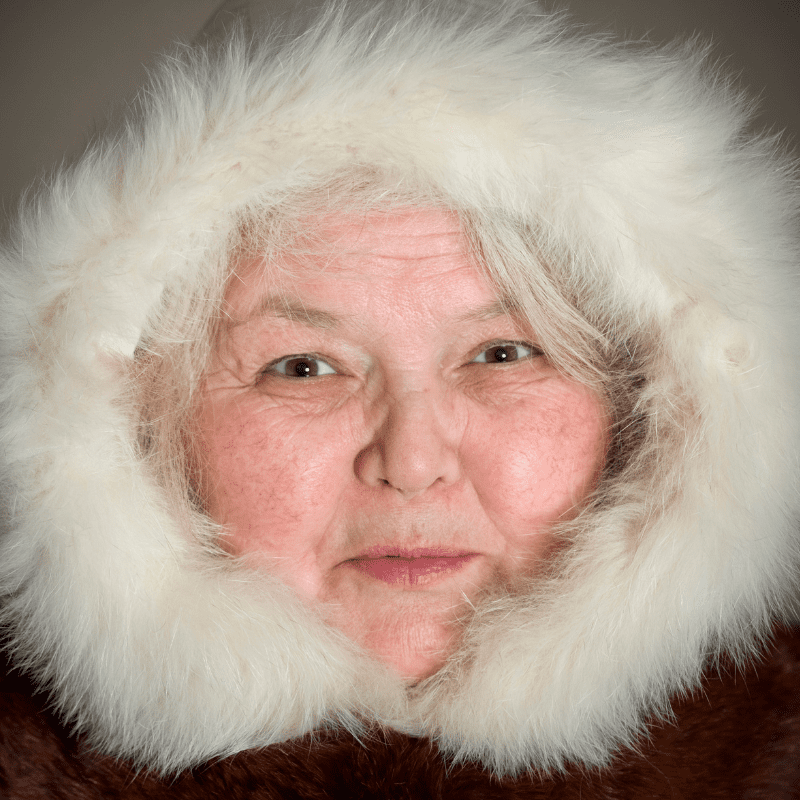 Wise Chukchi woman cheerful looking at the camera