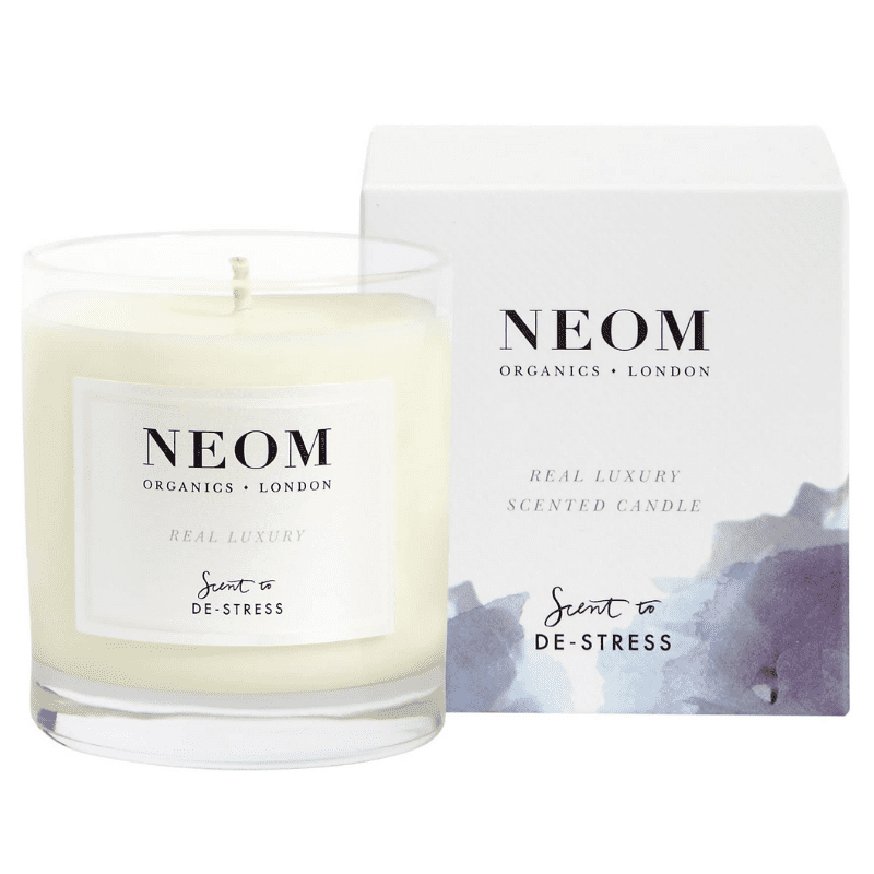 A candle and box by Neom Organics