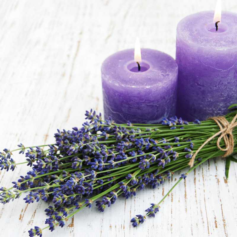 Lavender candles with lavender plants laying near by