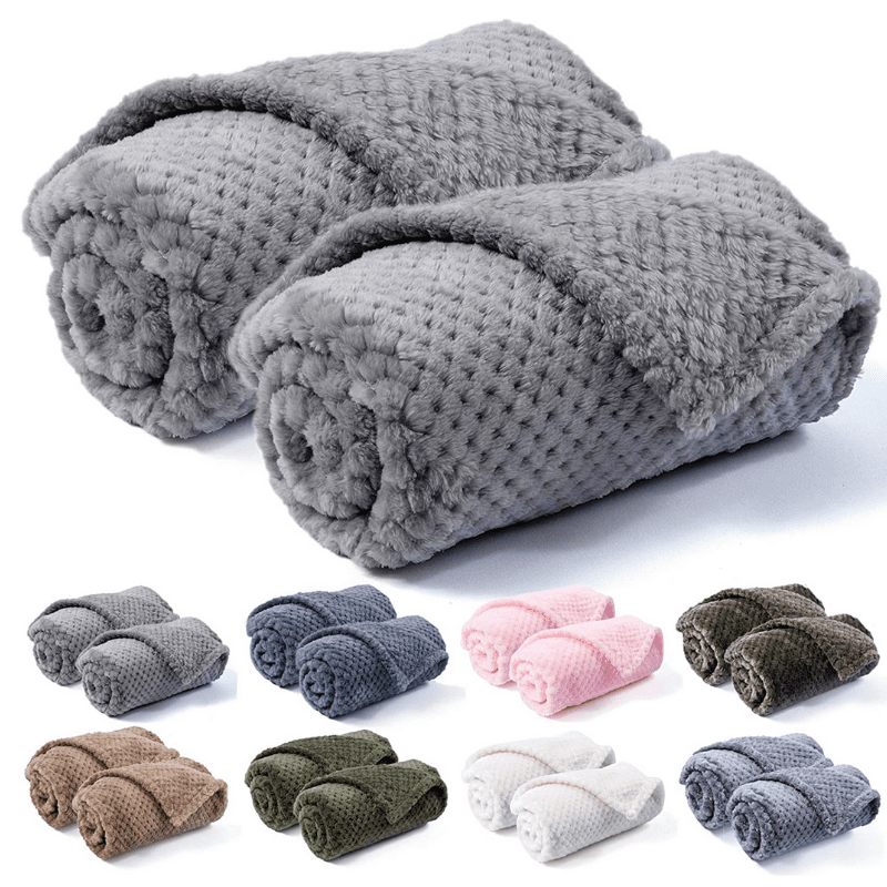 Luxury blankets in eight colours on a white background