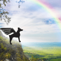 Rainbow and a silhouette of a dog with wings